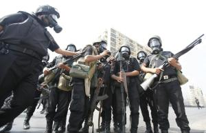 Riot police gather during clashes with members of the Muslim Brotherhood and Mursi supporters