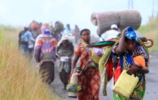 Displaced families flee from renewed fighting between the Congolese Revolutionary Army (CRA) and Congolese army in Sake