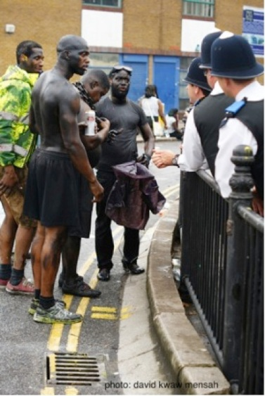 Early carnival goers argue with the police about the chain one of them is wearing.