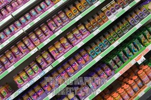 Curry pastes and sauces on a supermarket shelf