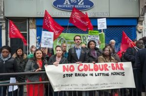 Protesters with leaflets 'No Colour Bar' against illegal colour bar operated by two Willesden letting agencies