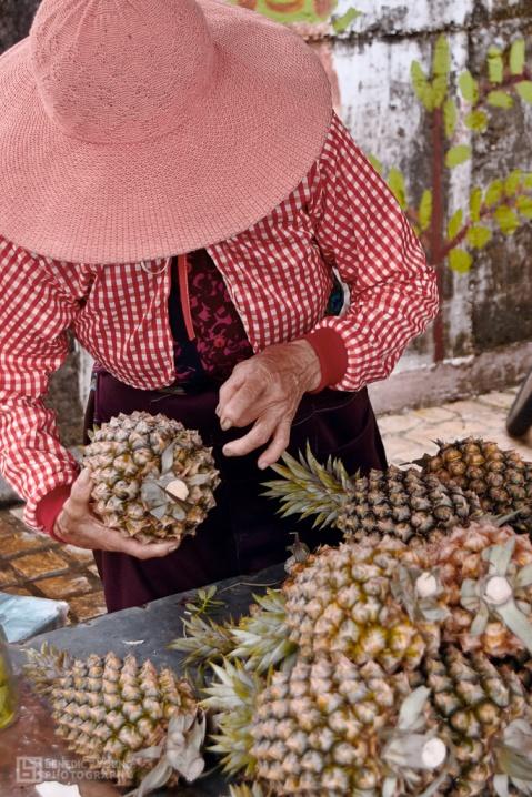 Lady Selling Taiwan's Abundant Pineapples