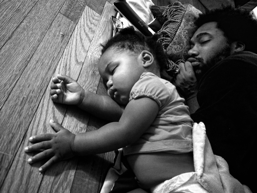 Anthony Francis and daughter Tena after falling asleep in front of the TV. Camp Lejeune, NC.