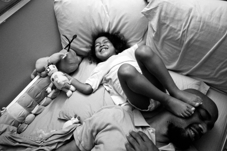 Bedtime shenanigans with Carlos Richardson and daughter Selah. Harlem, NY.
