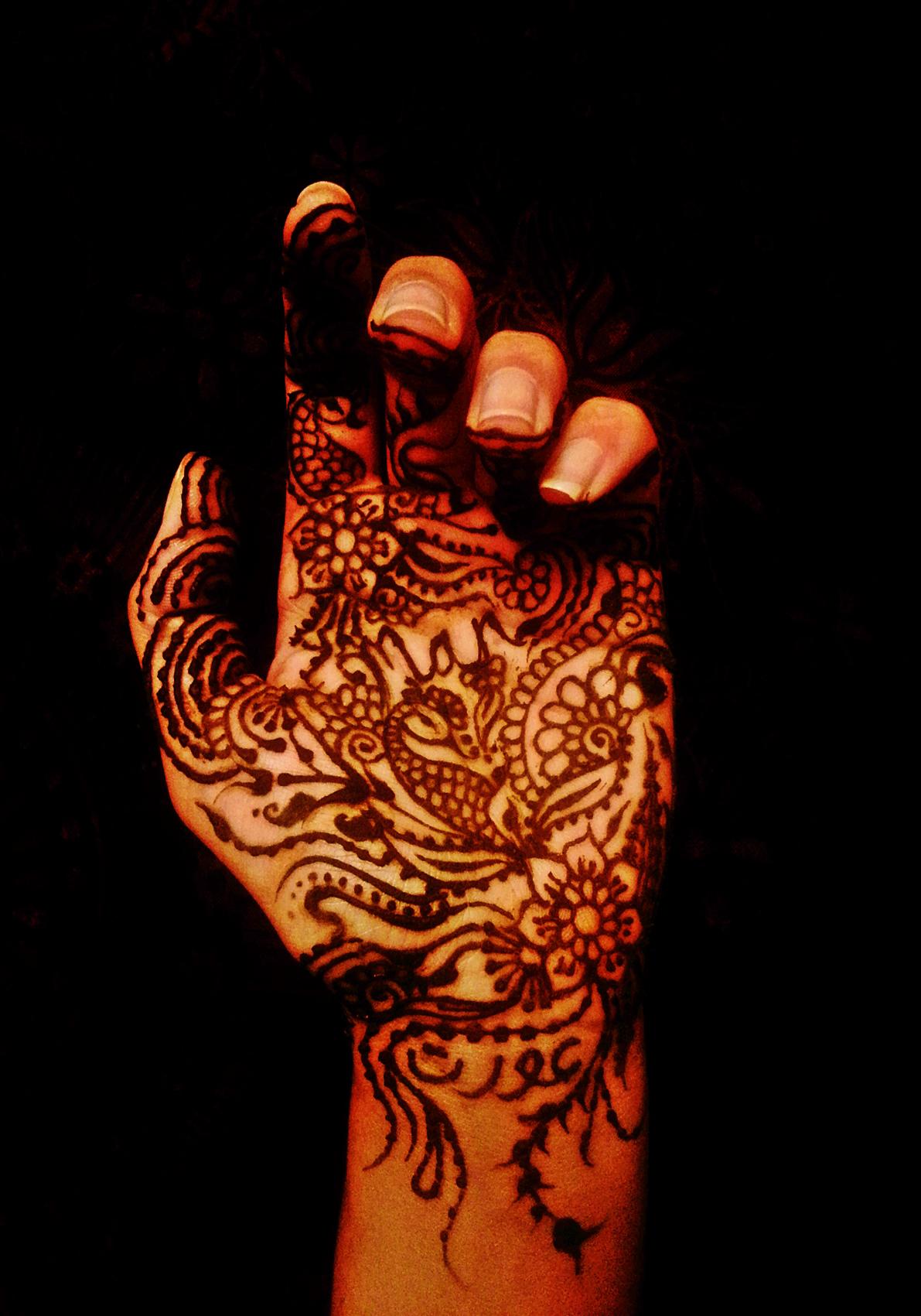 (At the base of my wrist, in Urdu script is 'Oarat' - Woman)