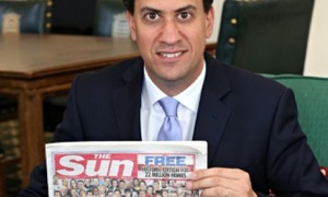 Ed Miliband holding his free copy of the Sun.