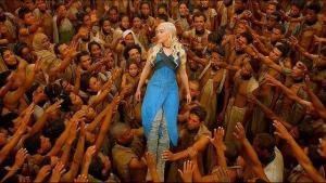 Daenerys bodysurfs the mystified slaves of Yunkai she has just freed from bondage.