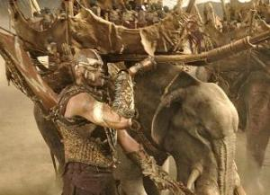 Scene from Peter Jackson's The Return of the King, where the Haradrim Mûmakil Mahûd leads his veiled armies into battle atop his monstrous war beast.