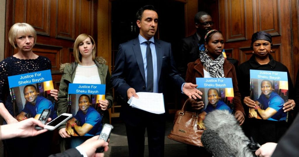 Aamer-Anwar-centre-and-Colette-Bell-second-left-the-partner-of-dad-of-two-Sheku-Bayoh-who-died-in-police-custody