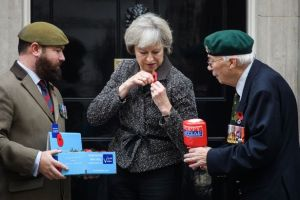 theresa-may-receives-her-remembrance-poppy-from-veterans