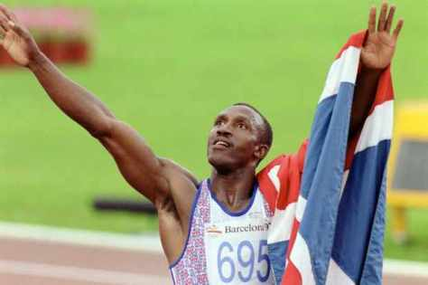 Linford Christie with a British flag after his vic